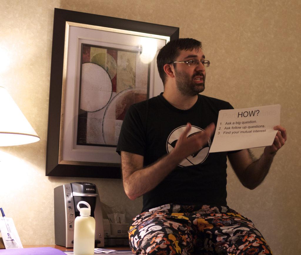 Jon holding up rules summary document